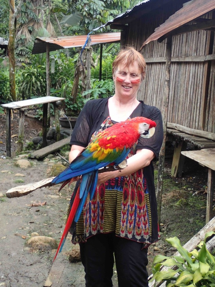 Kaye and the parrot (Photo and caption credit: Sue's blog)