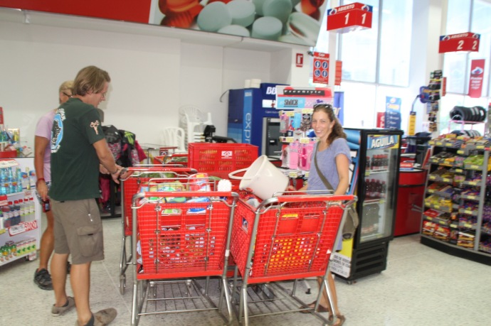Tour staff buying 5 trolleys of food to keep us going to the next rest day in San Marcos