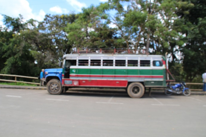 Side view Of the type of bus locals ride in around the countr