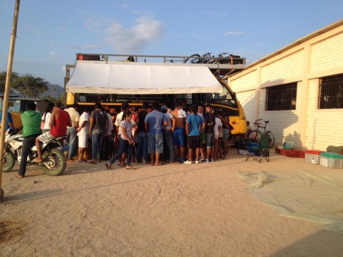 Locals watching dinner preparation