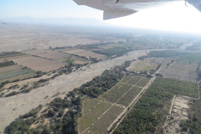 This is a general shot of the valley.  Lots of agriculture and a dry river.  A lot of the lines have been affected by water flows, whenever it happens  (Photo and caption credit: Laura and Greg's blog)