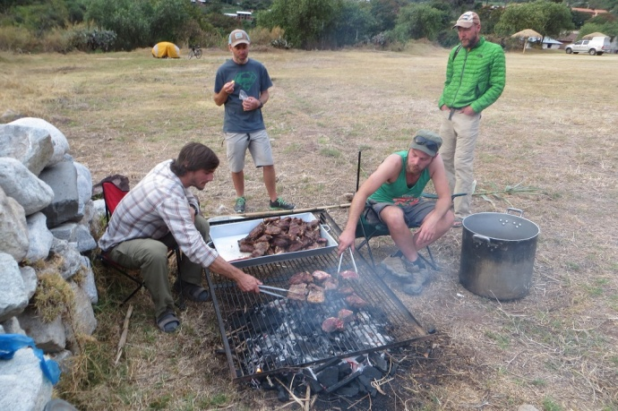 And, here are some of the staff cooking steak for dinner. Peter and Jason (riders) are supervising (Photo and caption credit: Laura and Greg's blog)