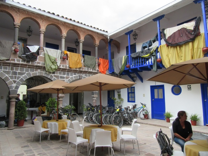 This is what happens when a bunch of cyclists show up and stay in your hotel.   We're in a beautiful little hotel, so what do we do?  Hang our tents and laundry out everywhere to dry.  Honestly, this is a pretty little courtyard (Photo and caption credit: Laura and Greg's blog)