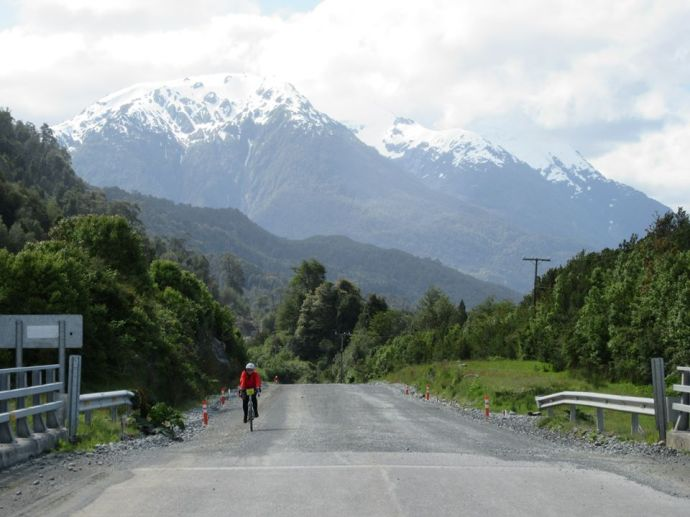 Me riding with mountains in the background (Photo credit: TDA Global Cycling Facebook page)