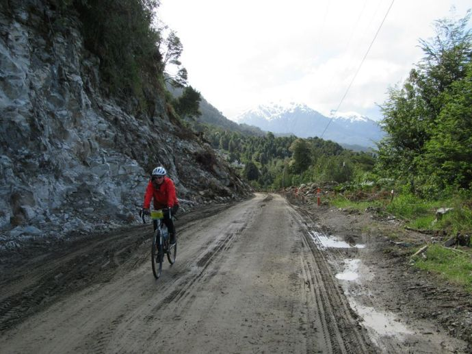Me biking along the Carretera Austral which is constantly under construction (Photo credit: TDA Global Cycling Facebook page)