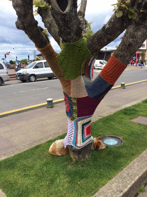 A knitted tree, and sleeping dog